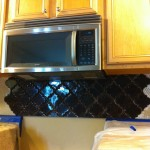 beveled arabesque tile under microwave