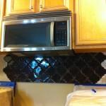 beveled arabesque tile under microwave