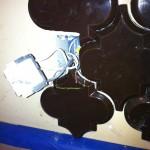 beveled arabesque tile marked for bottom of outlet cut