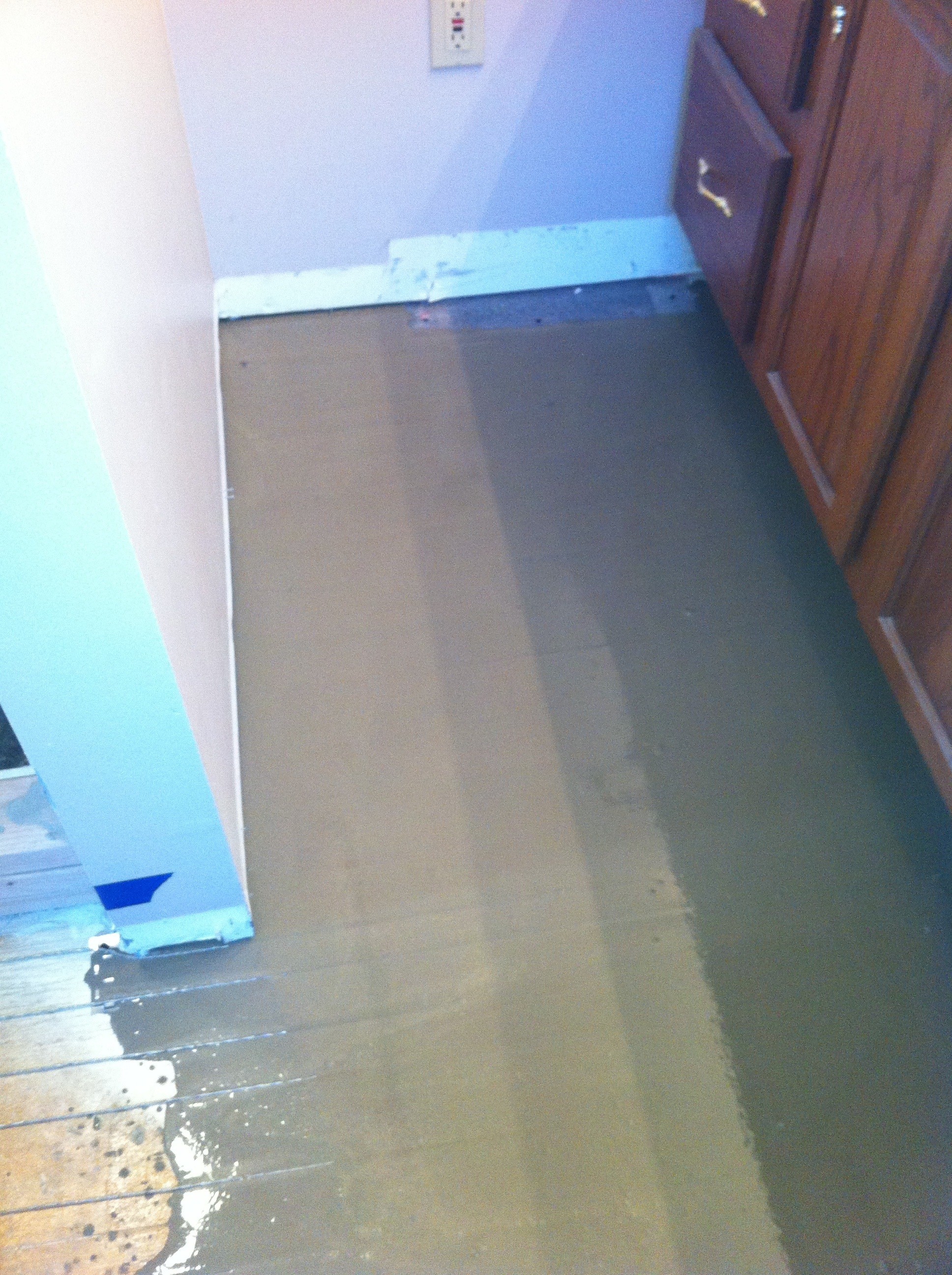 Self leveler installed over warm wire columbia missouri for Columbia flooring installation instructions