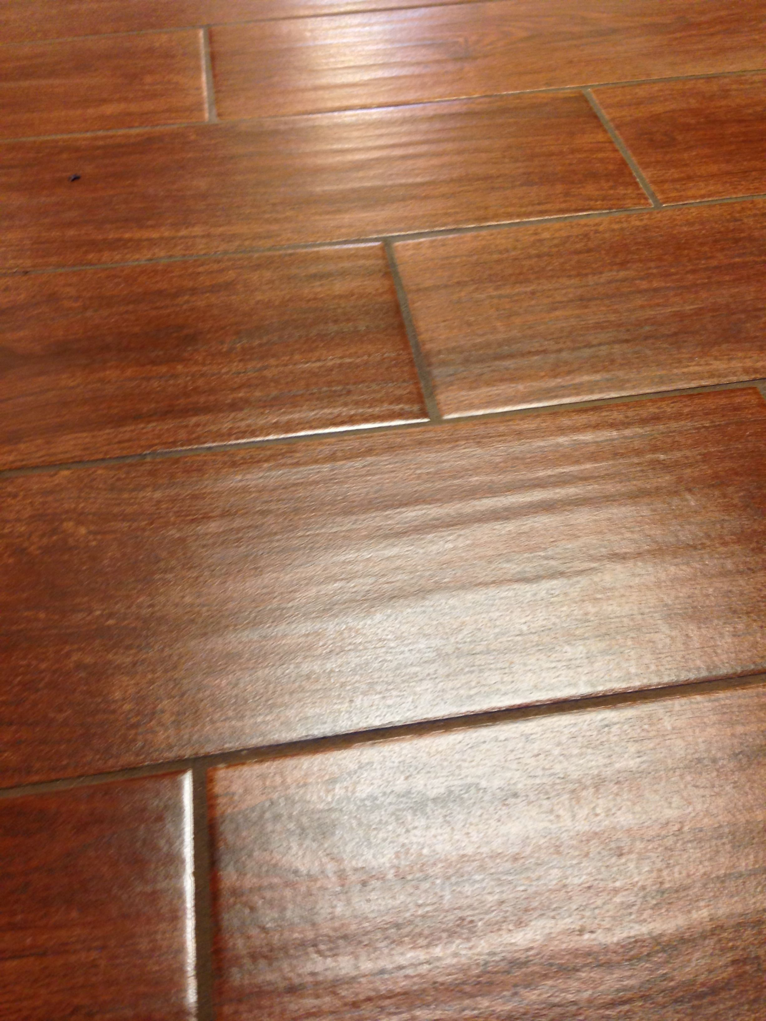 Wood look tile close up columbia missouri bathroom for Hardwood floor tile kitchen