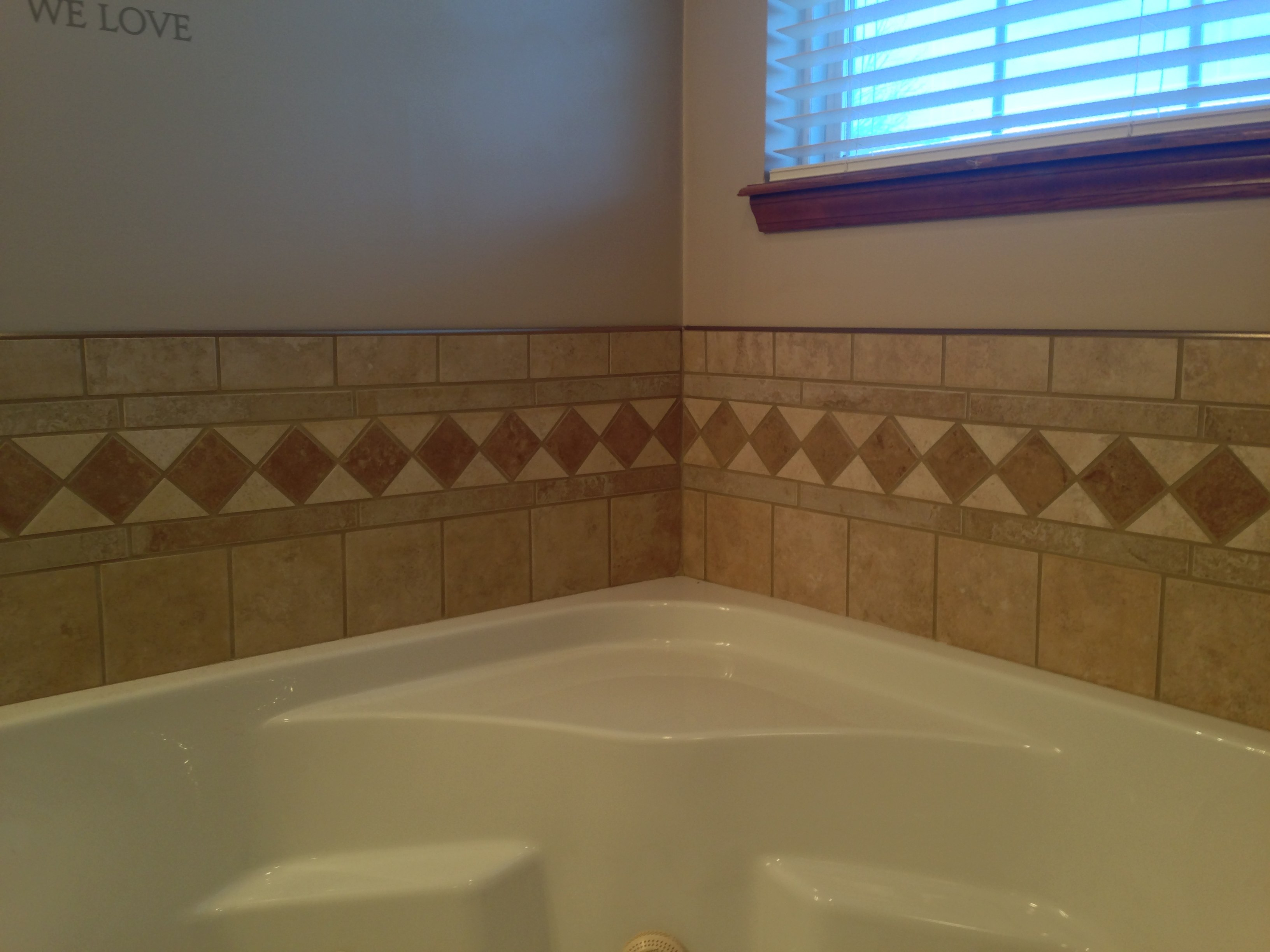 Custom tile border jettet tub
