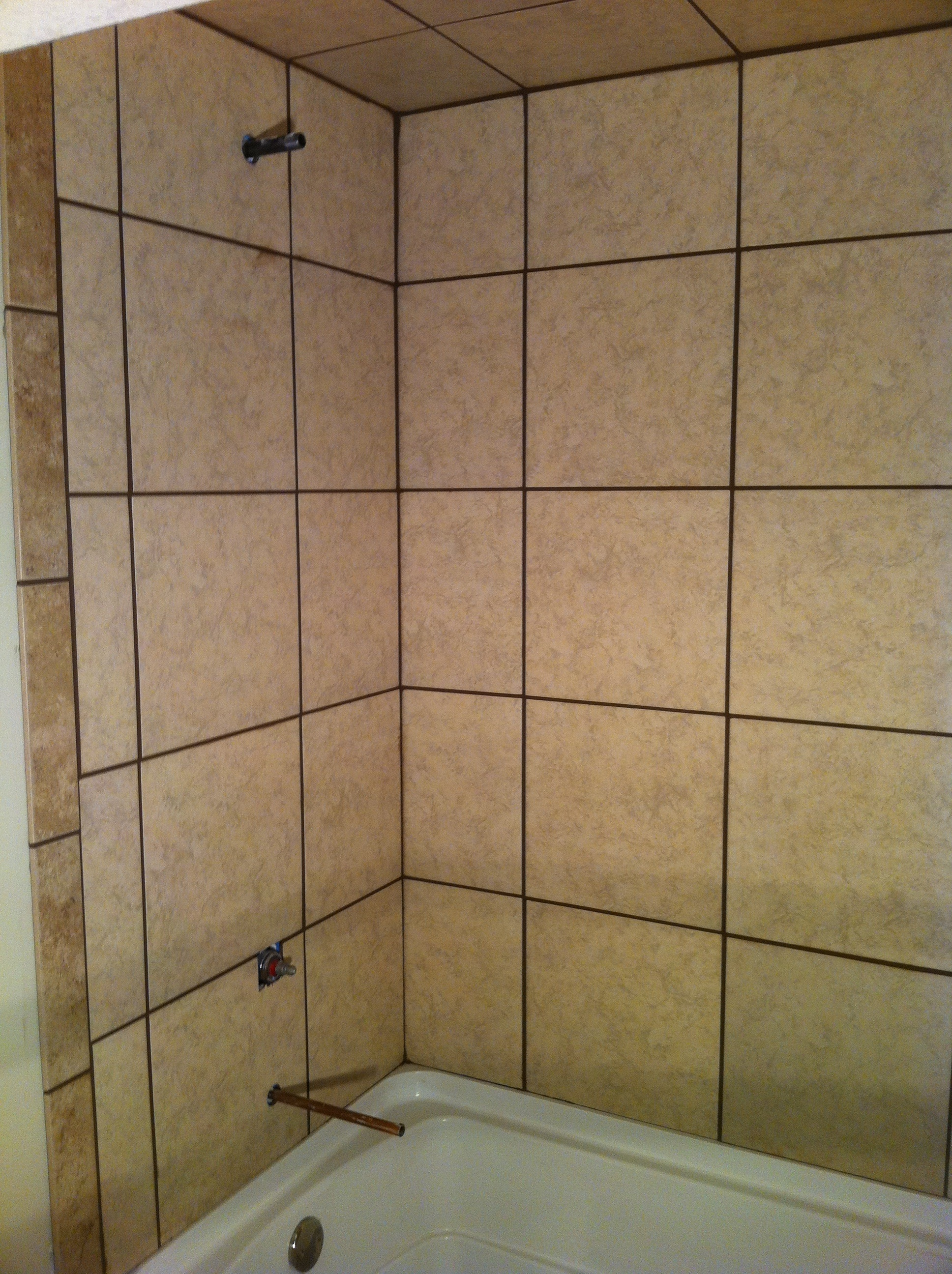 Basement tile tub surround columbia missouri bathroom for Tile shower surround