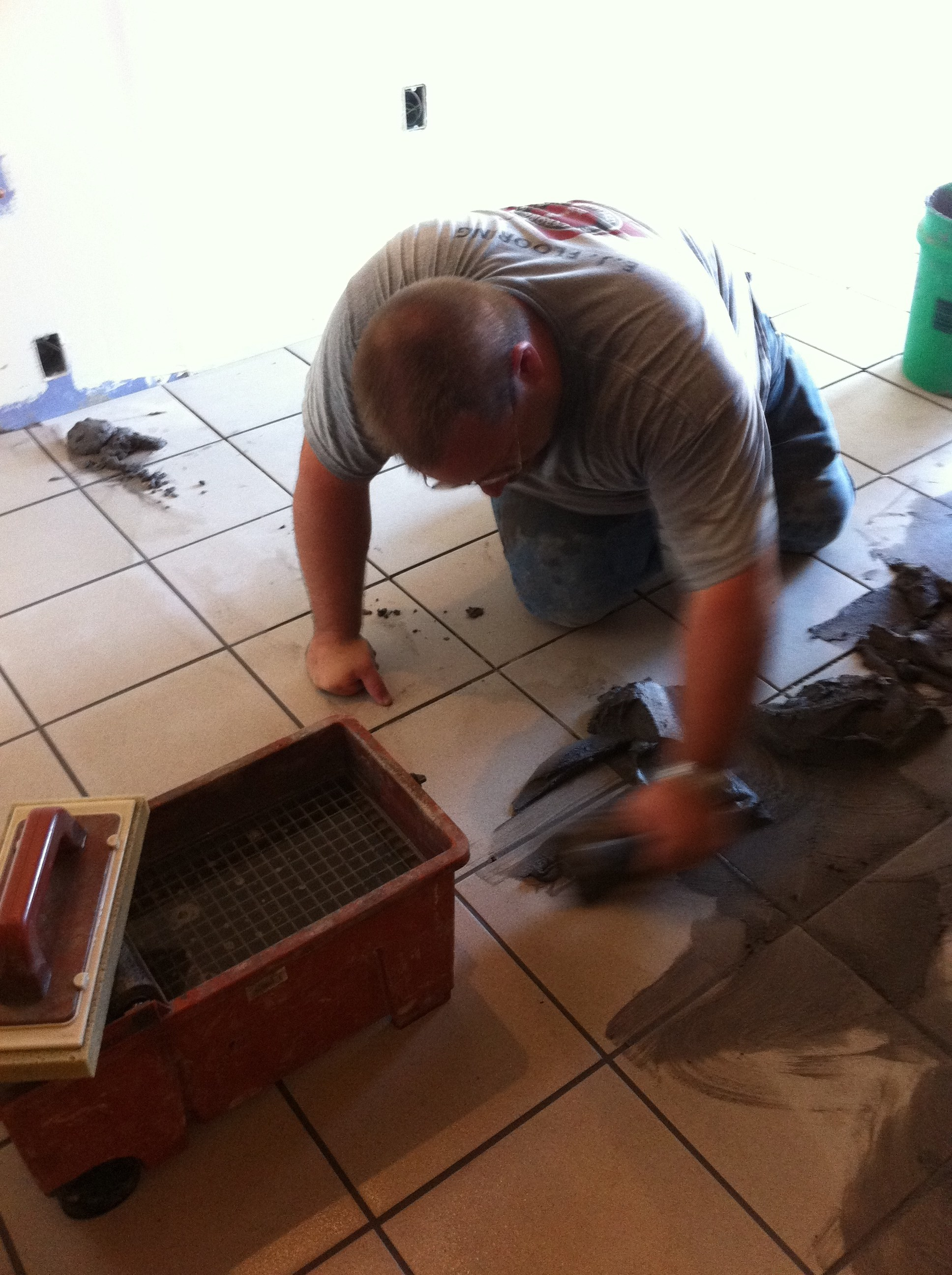 Eric Blumer grouting more tile