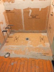 Heated shower floor