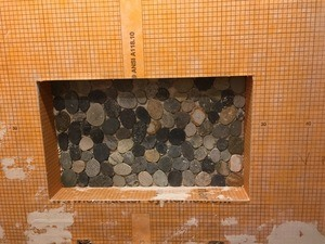 Pebbles in niche